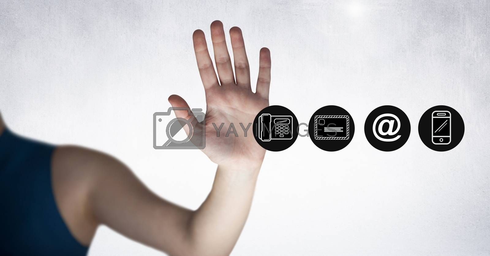 Close-up of hand beside communication icon set against white background