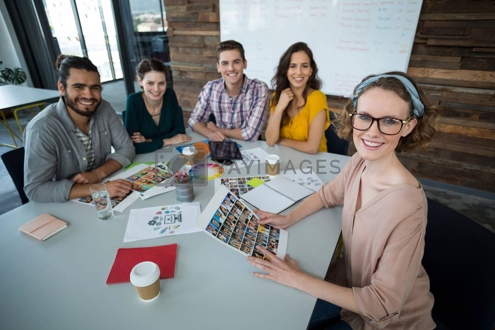 Portrait of smiling graphic designers sitting in office