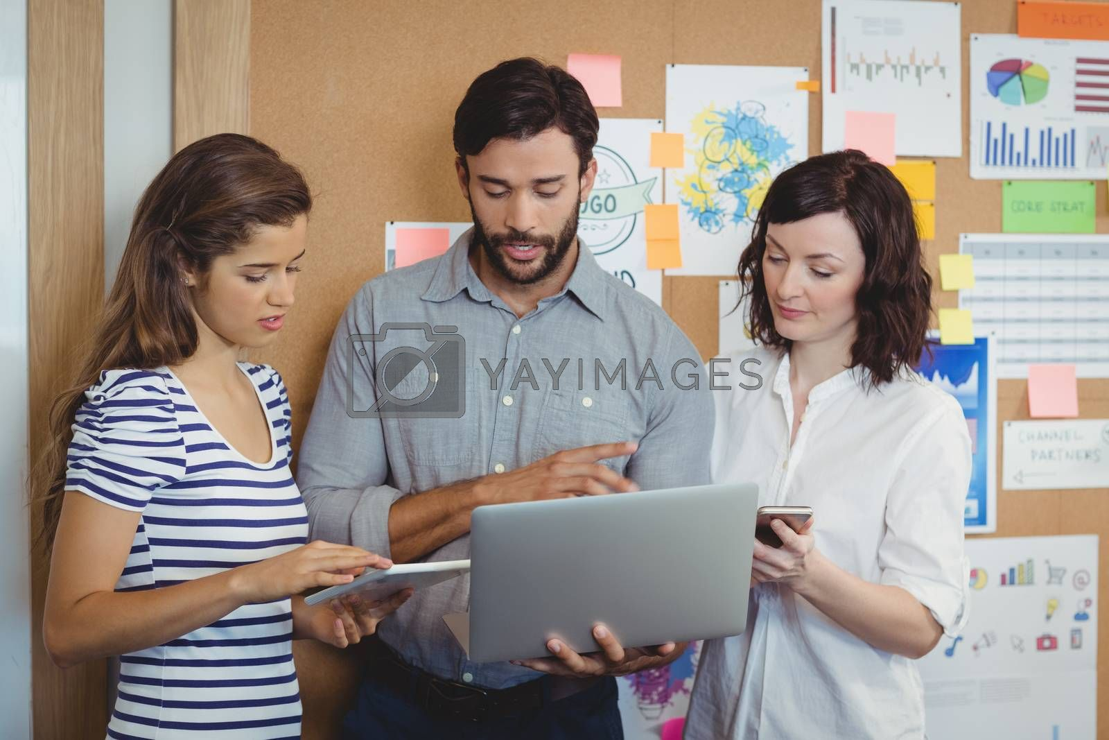 Team of business executives working together in office