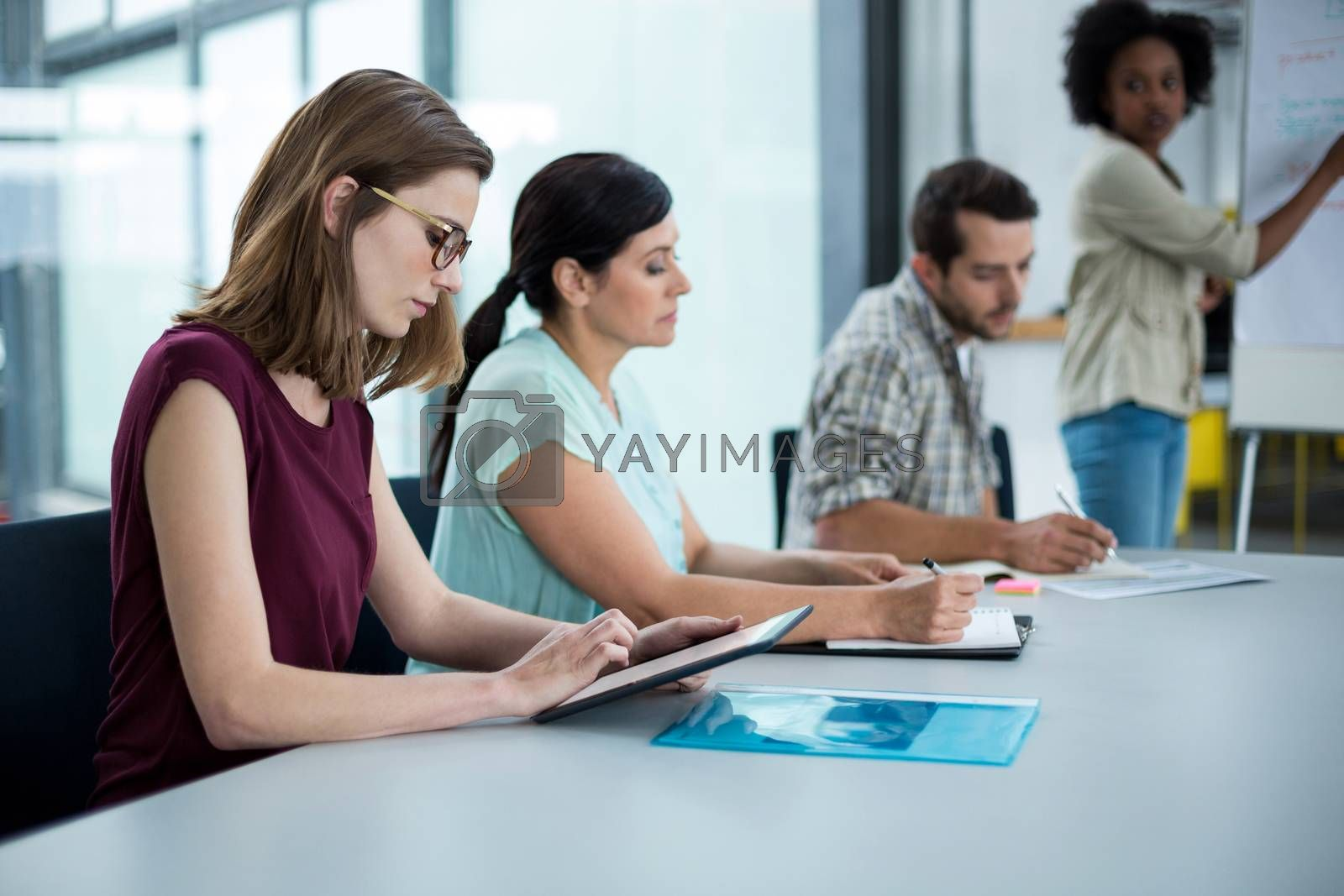 Business executive using digital tablet in meeting at office