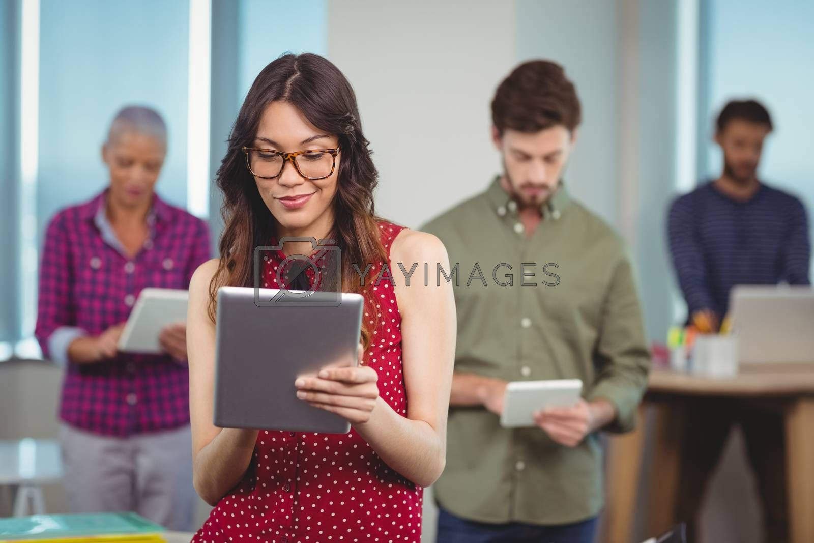 Business executives using digital tablet in office