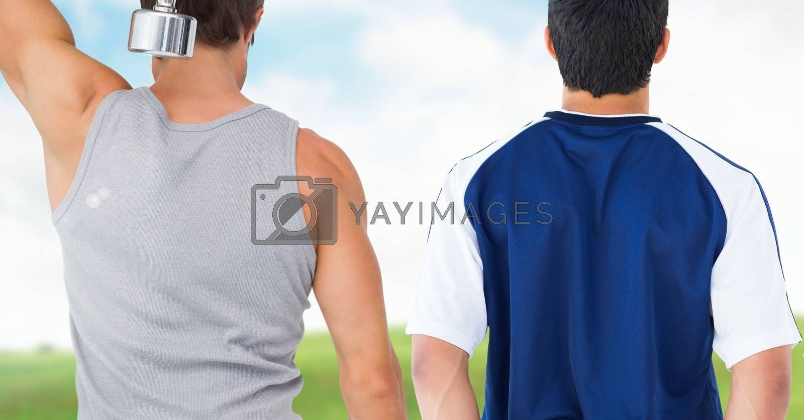 Fitness men back making fitness exercises against countryside background by Wavebreakmedia