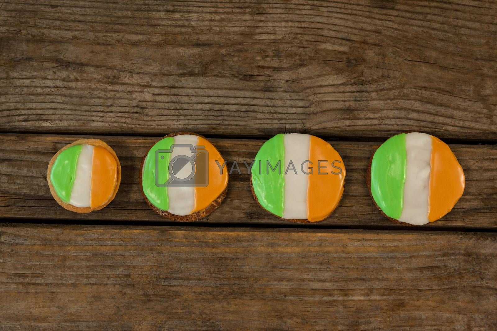 St. Patricks Day four cookies with irish flag toppings on wooden background