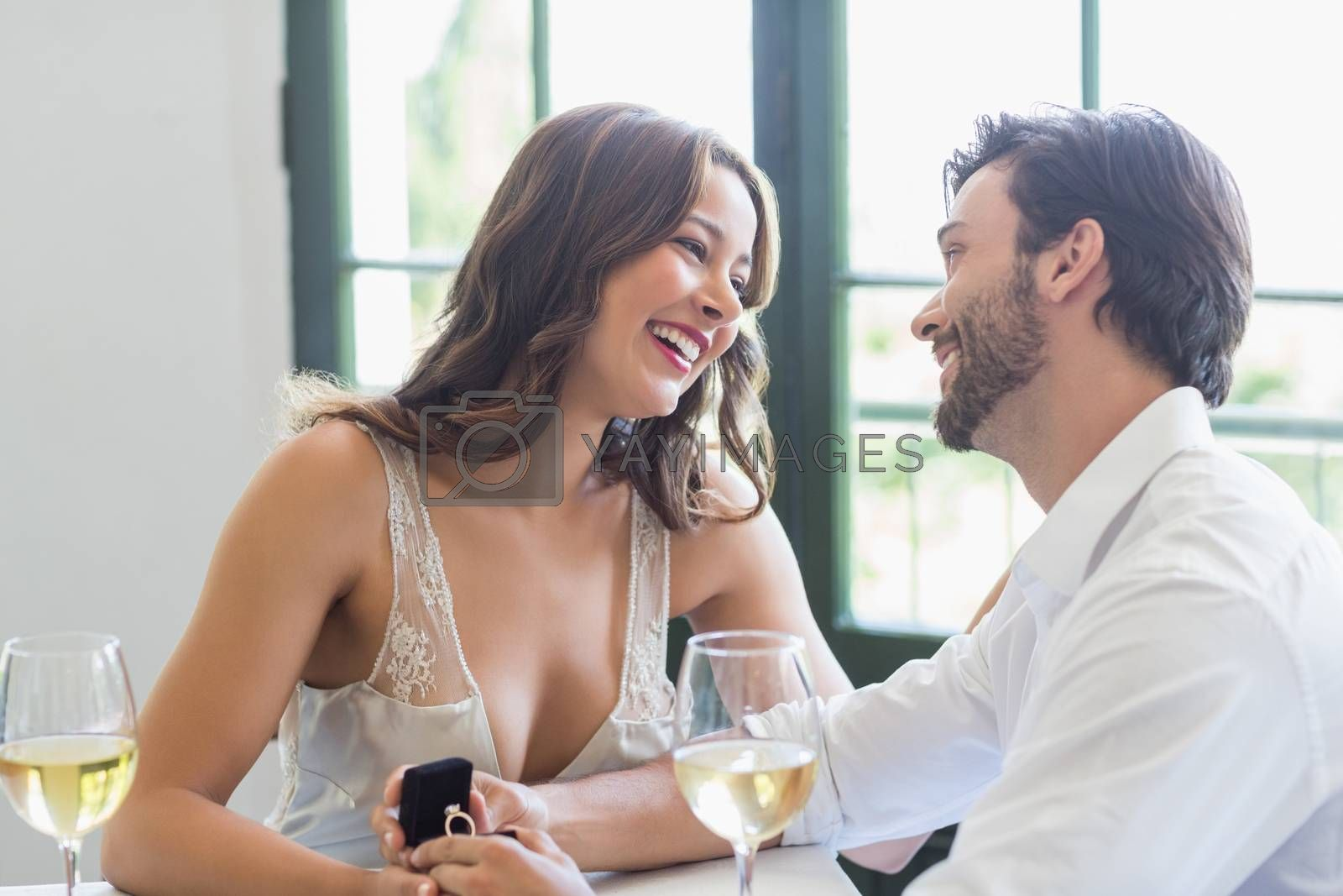 Couple smiling while looking at each other in the restaurant