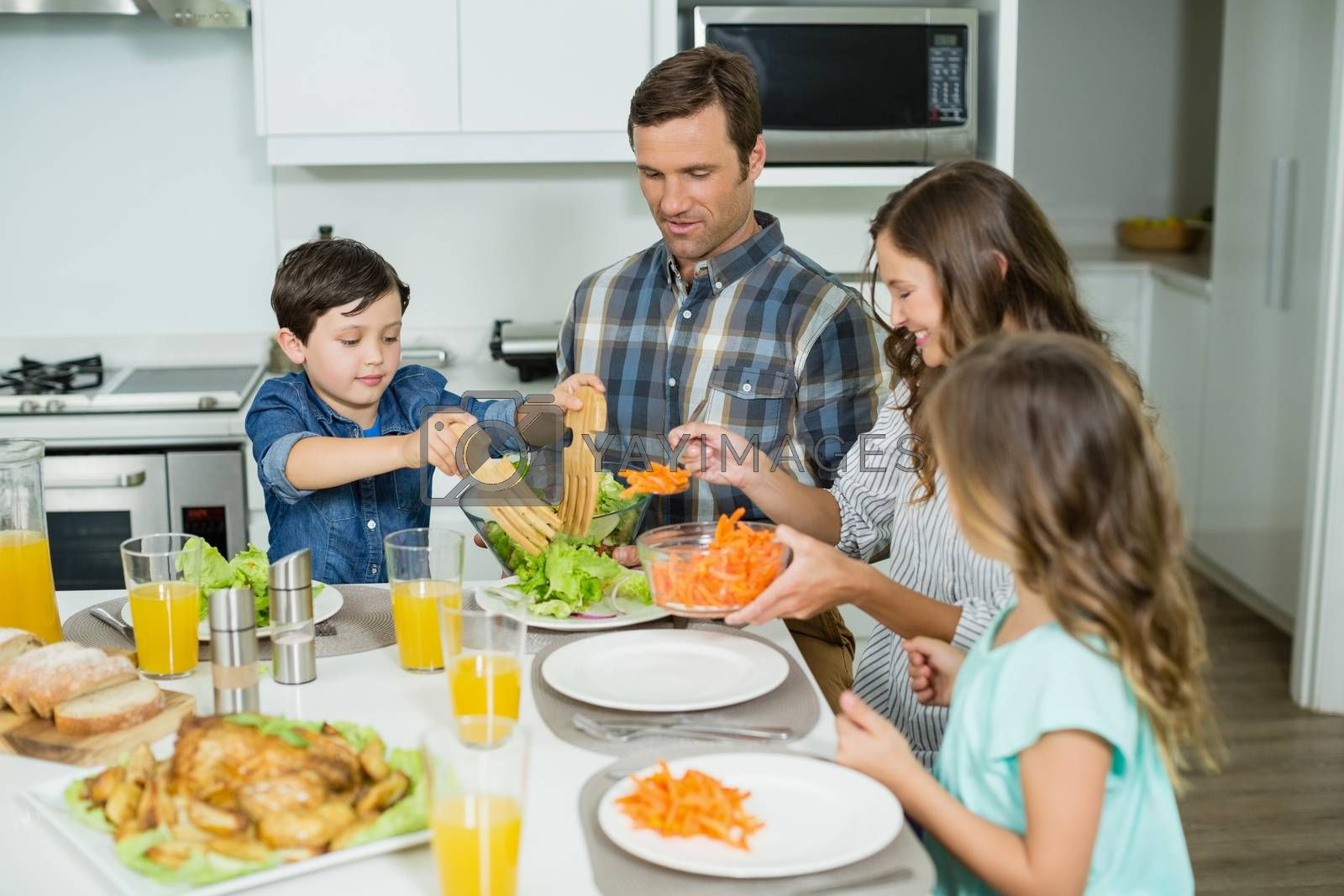 Smiling family having lunch together on dining table at home