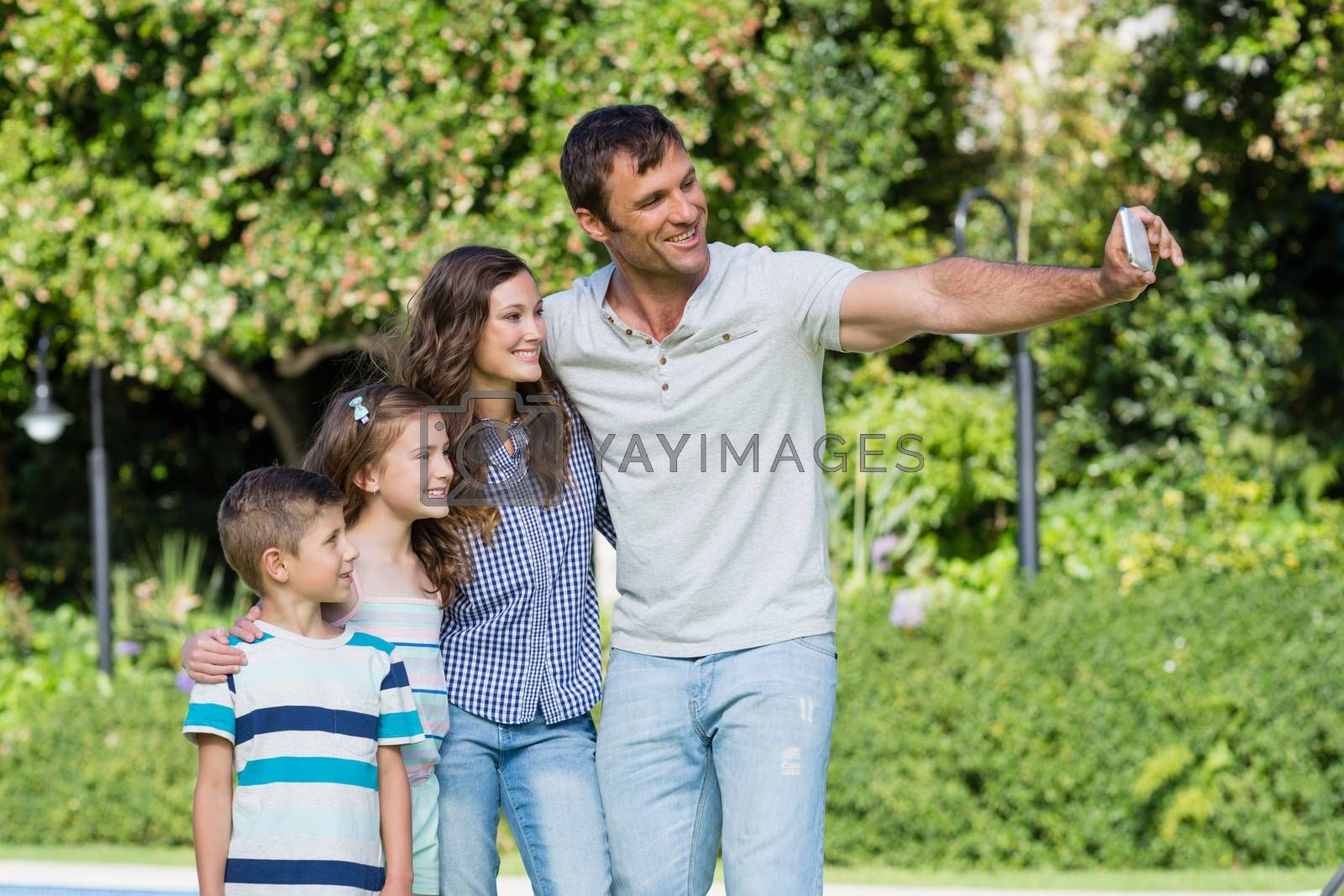 Happy family taking a selfie on mobile phone by Wavebreakmedia