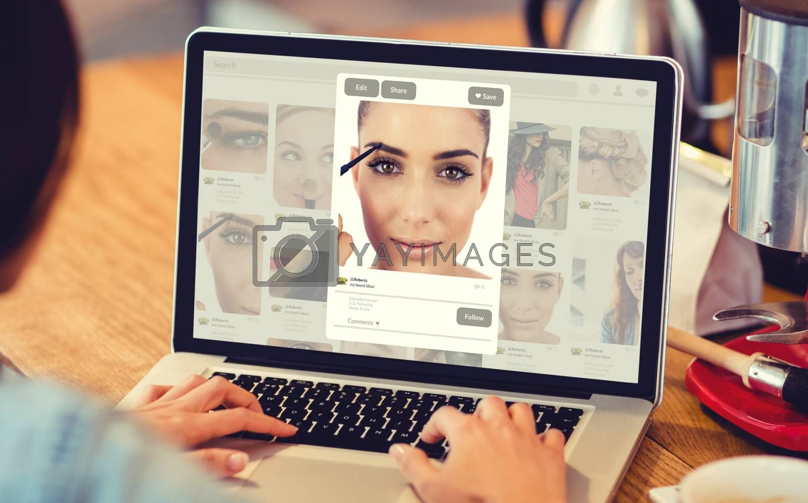 Composite image of website page against woman using laptop at office