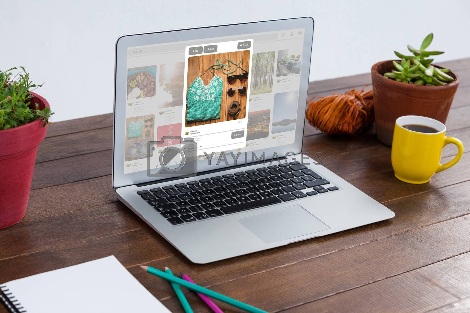 Laptop with pot plant and coffee mug in wooden table against composite image of website page