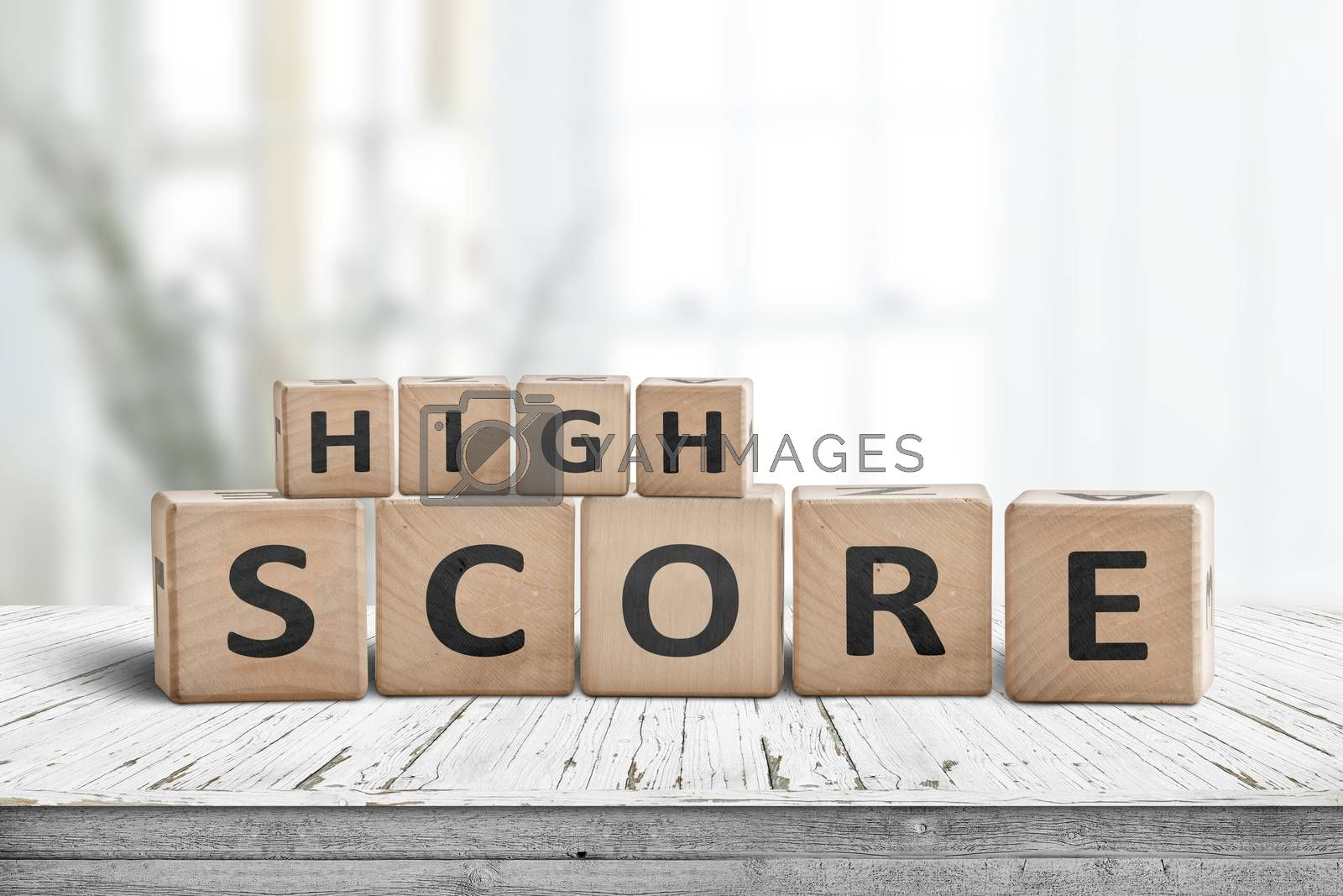 High score sign on a table in a bright home with green plants in the living room