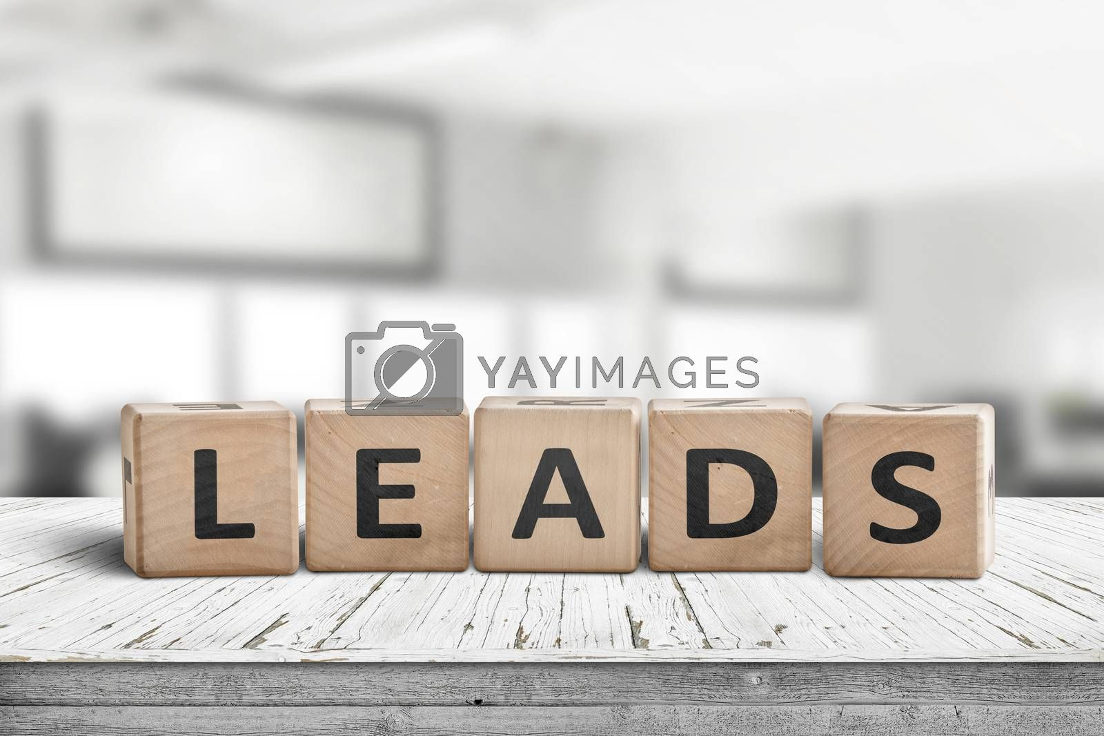 Leads sign in a bright office environment on a wooden desk with blocks