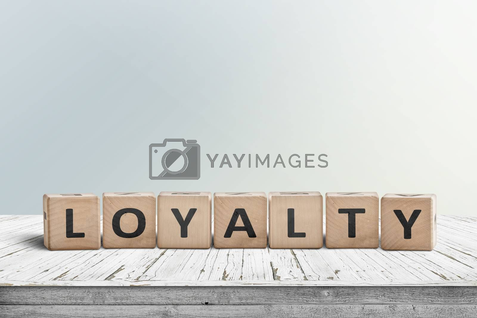 Loyalty sign on a wooden table in bright daylight in a room