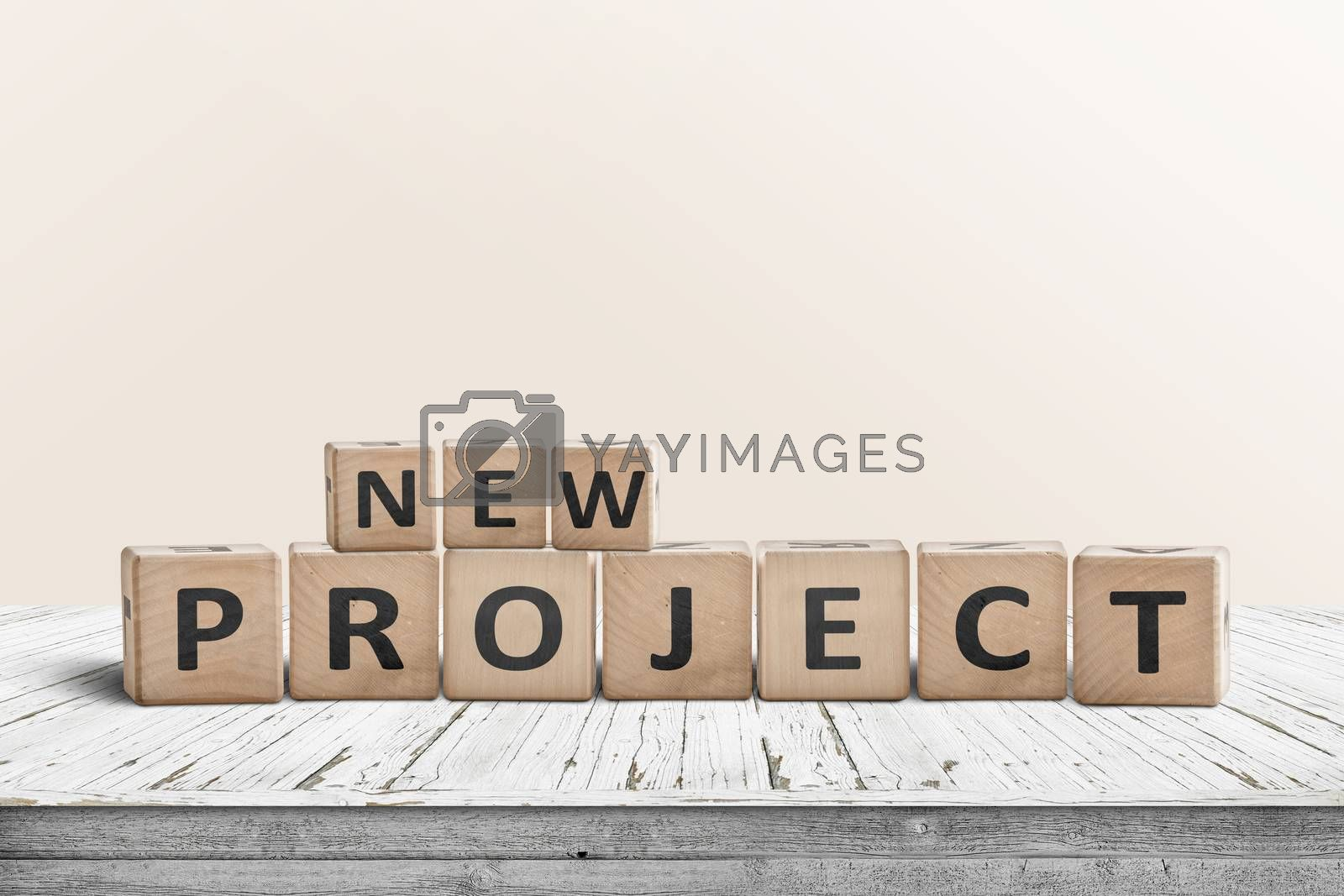 New project message on a wooden table in a bright room