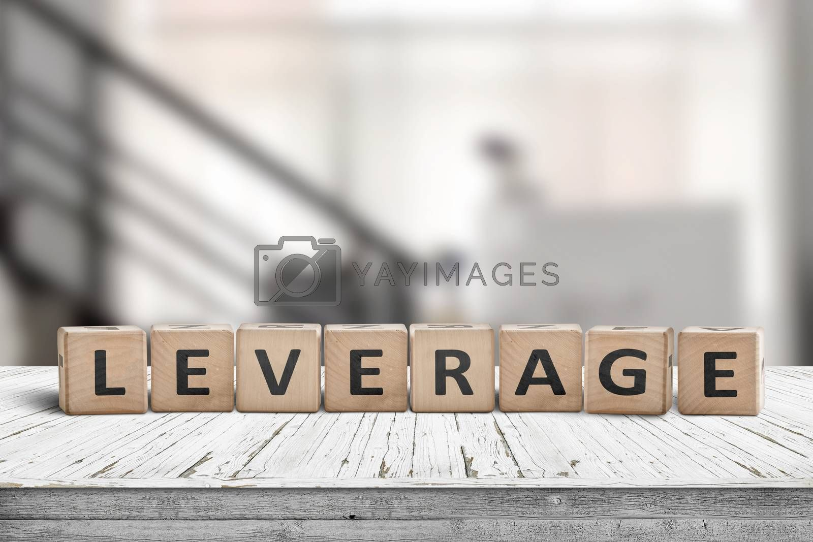 Leverage sign in a office environment on a wooden desk