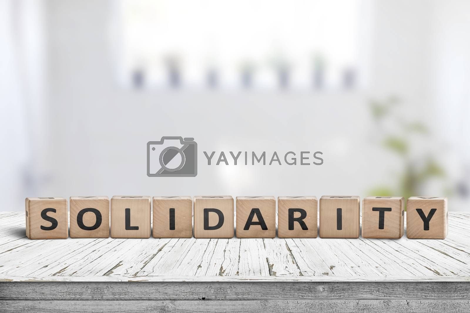 Solidarity message on a wooden table in a bright living room