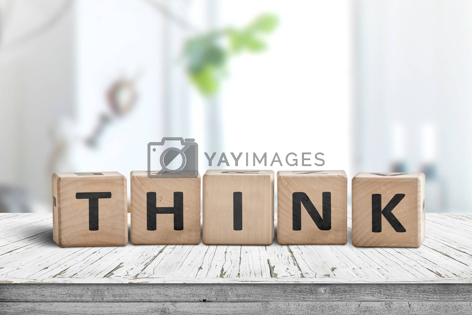 Think message sign on a worn table in a bright room in daylight