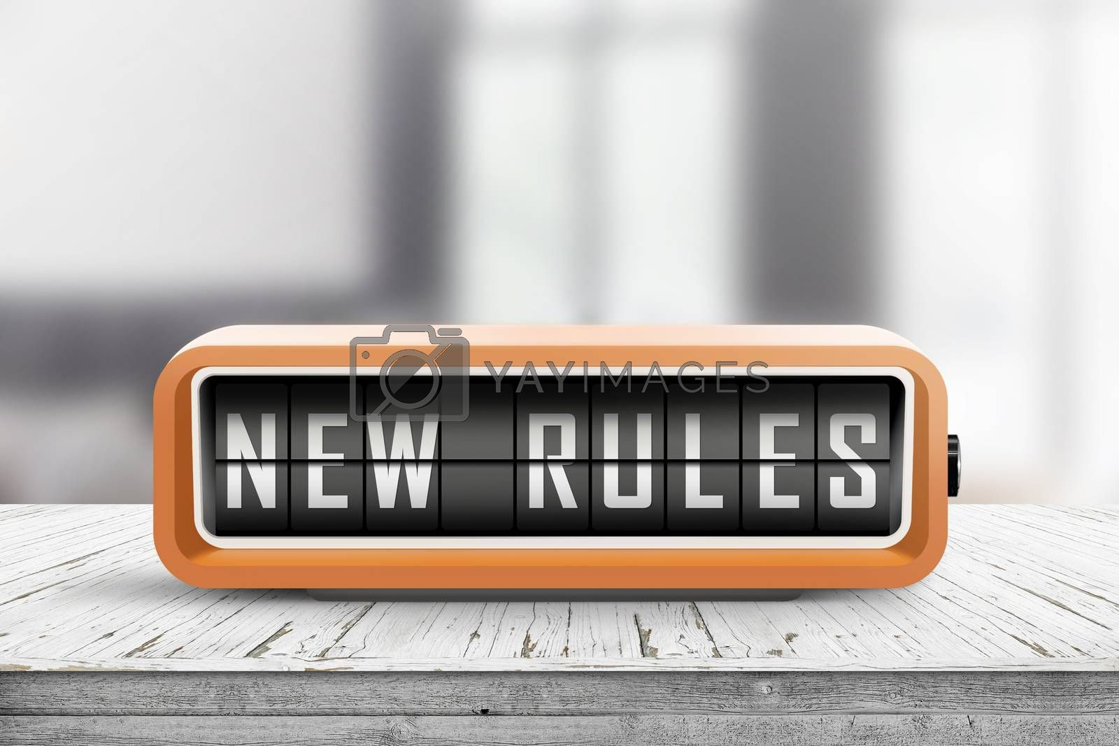 New rules alarm message on a wooden desk in a bright indoor environment
