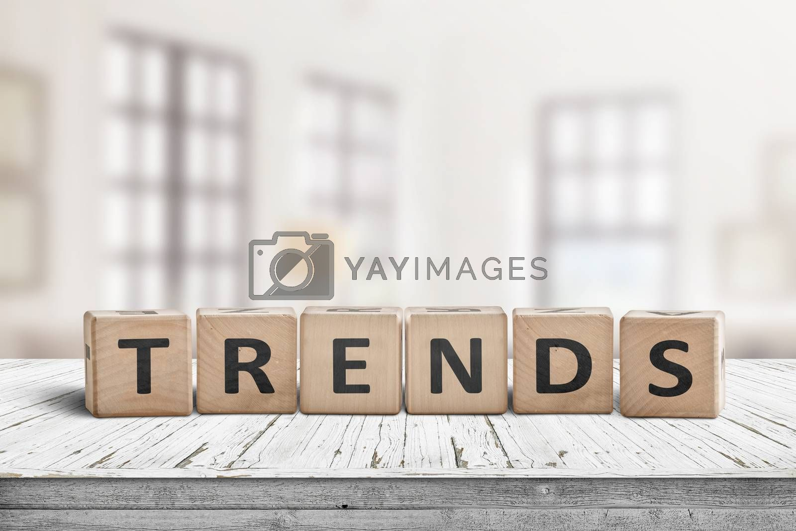 Trends sign in a bright home on a wooden desk with white paint
