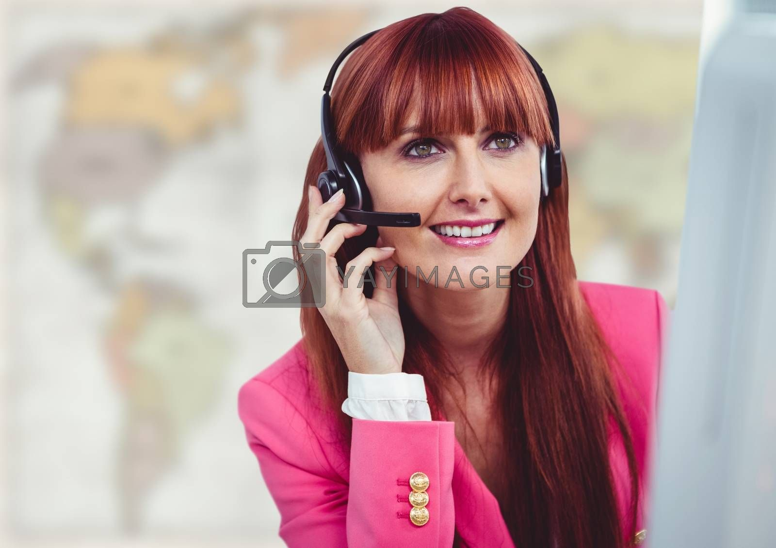 Digital composite of Travel agent at computer against blurry map