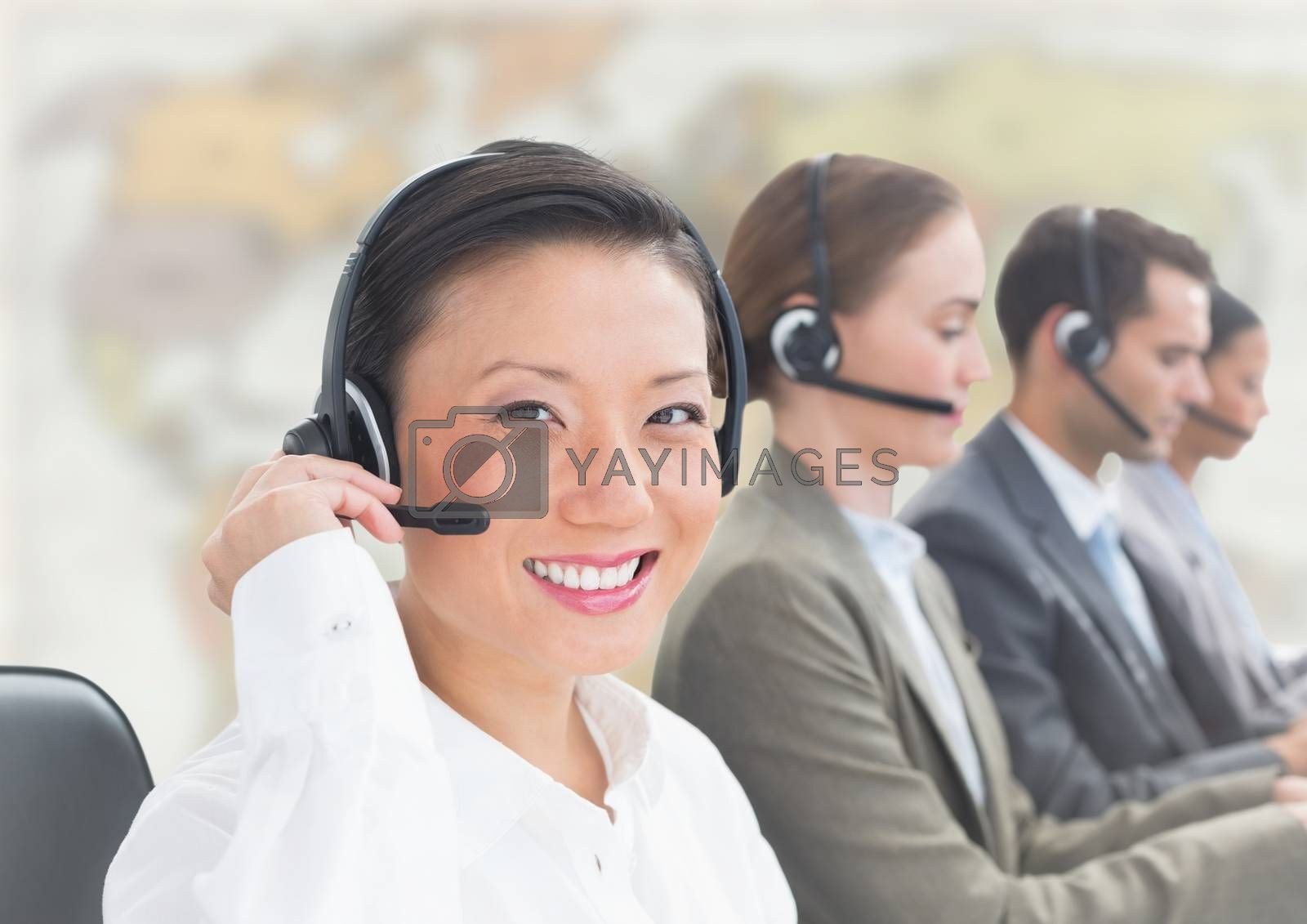 Digital composite of Travel agents with headsets against blurry map