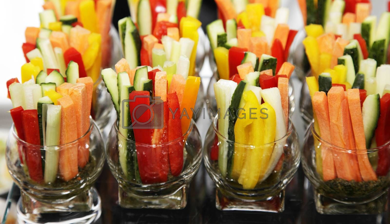 transparent glass with slices of fresh vegetables