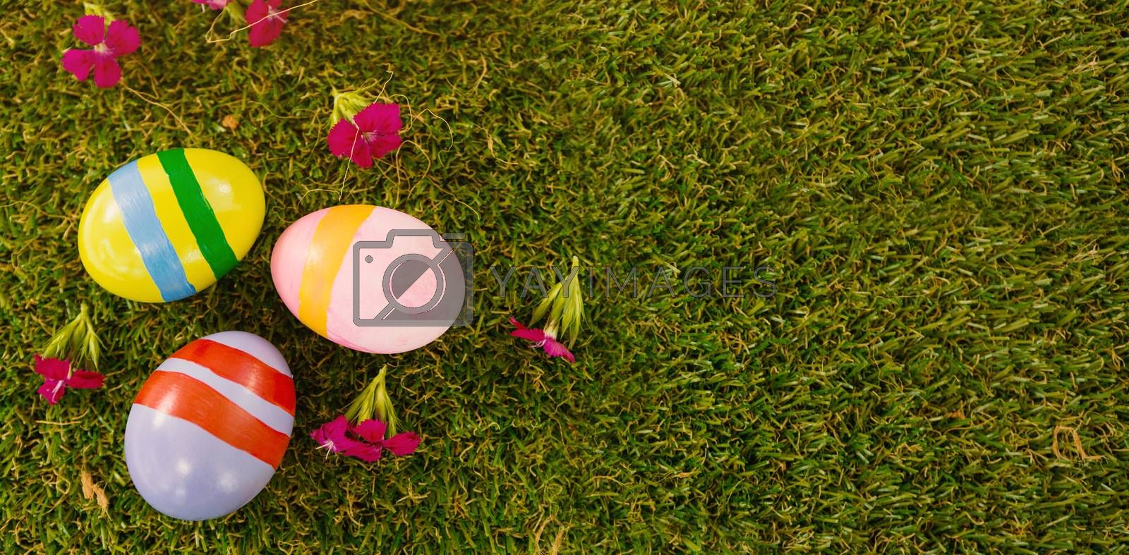 Overhead view of painted Easter egg on green grass
