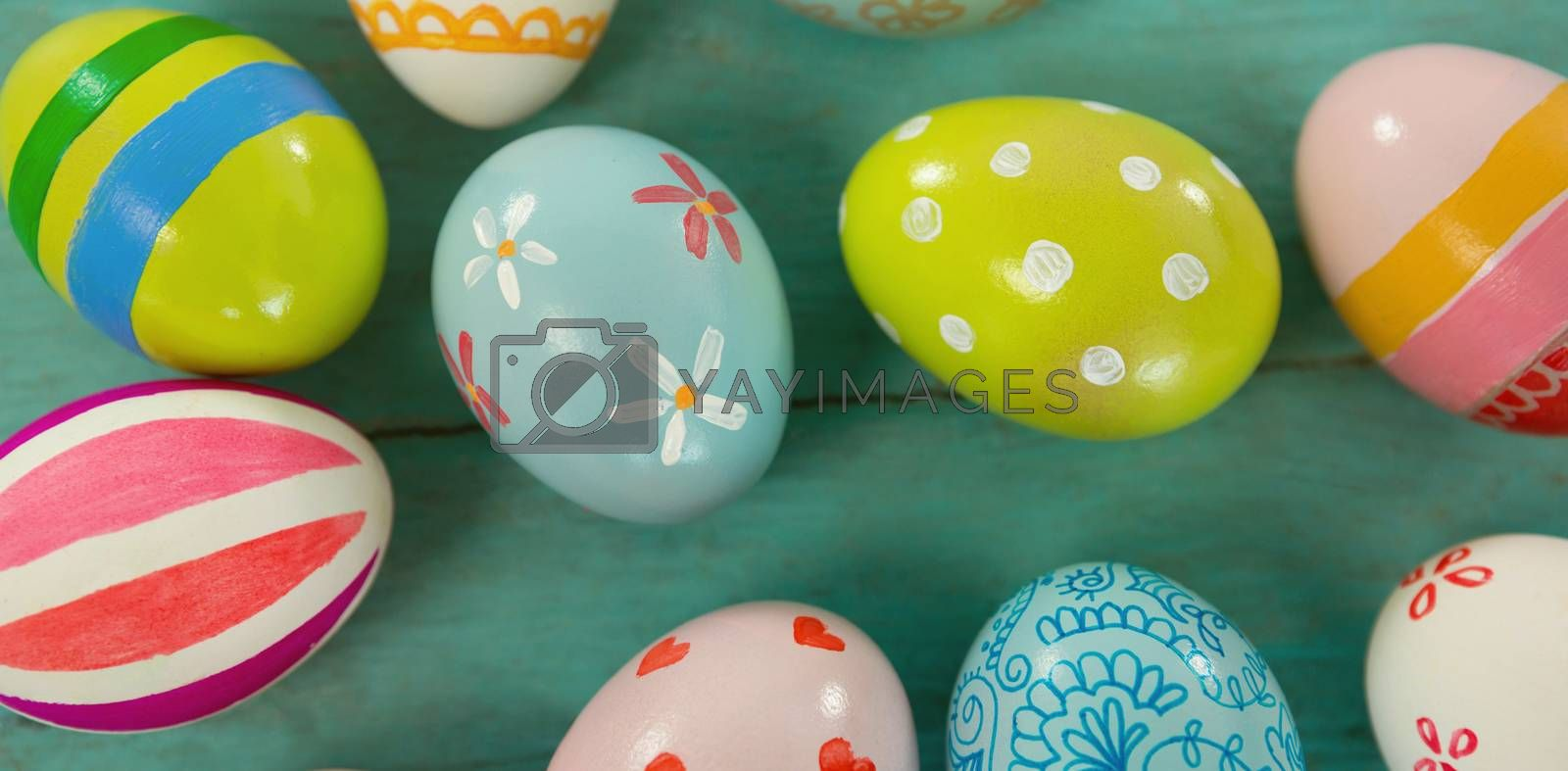 Close-up of painted Easter eggs against blue wood background