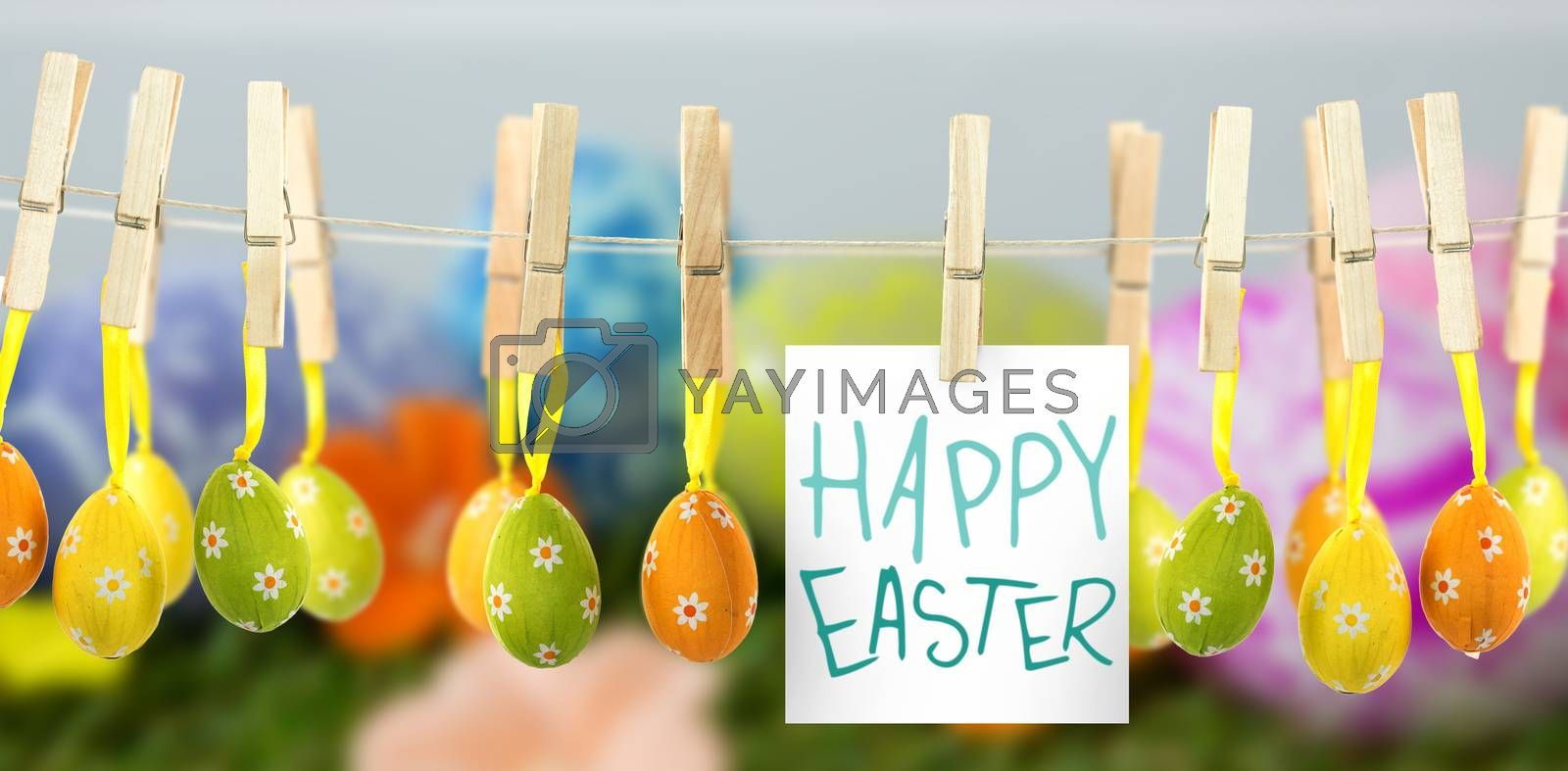 Easter greeting against painted easter egg on grass