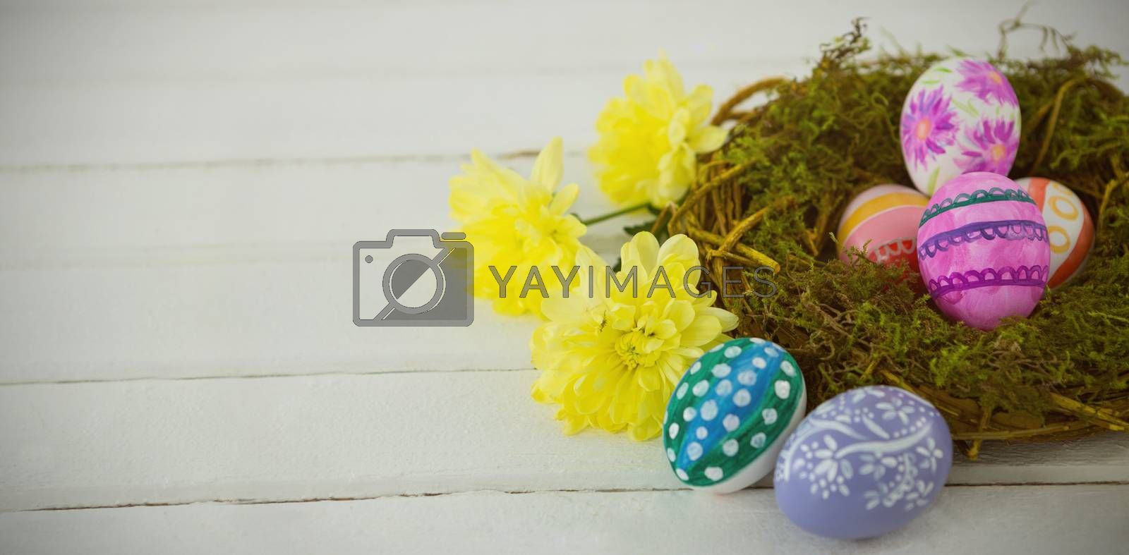 High angle view of colorful Easter eggs in nest