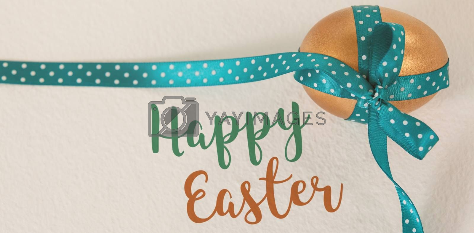 Easter greeting against golden easter egg tied with blue ribbon