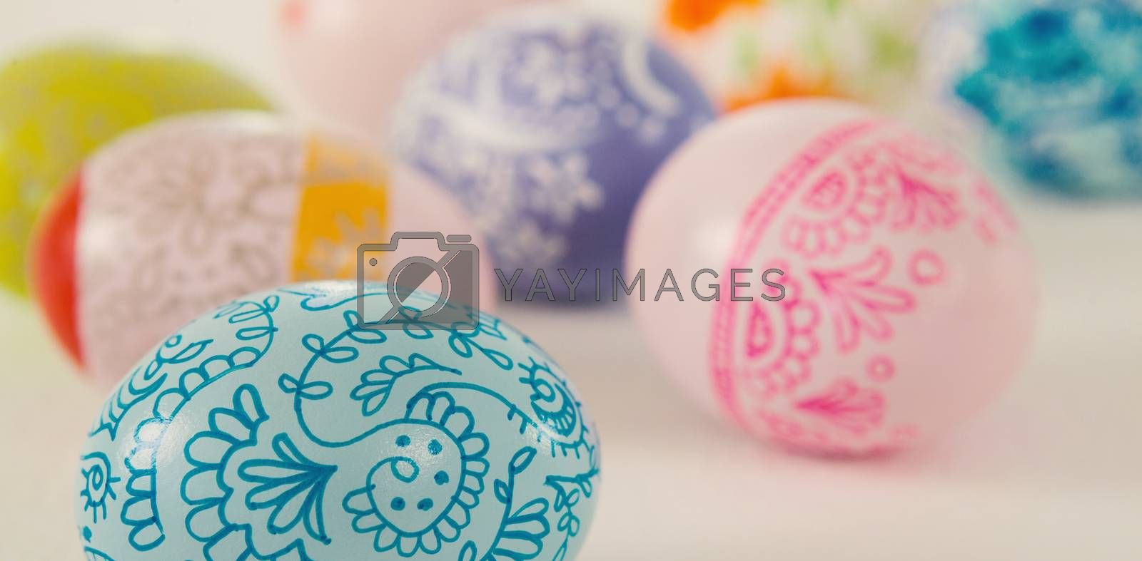 Close-up of colorful Easter eggs on white background