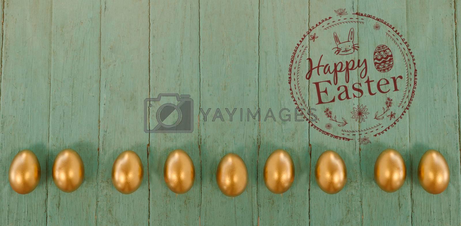 Happy easter logo against golden easter eggs arranged on wooden surface