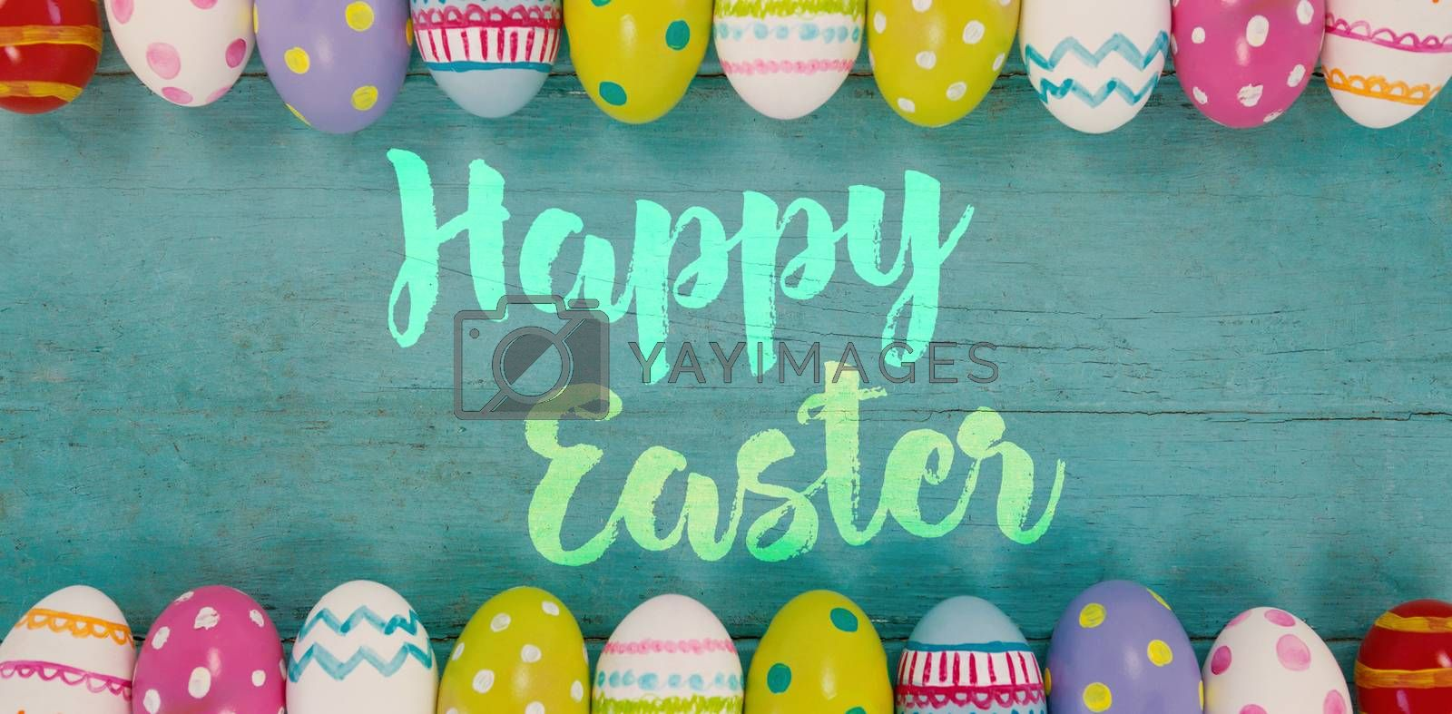 Happy easter logo against various easter eggs arranged on wooden surface