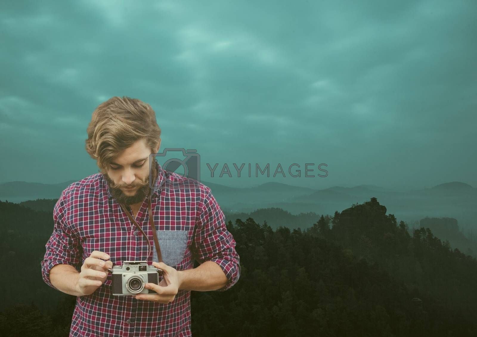 Digital composite of travel mountains. men with mustache with his camera
