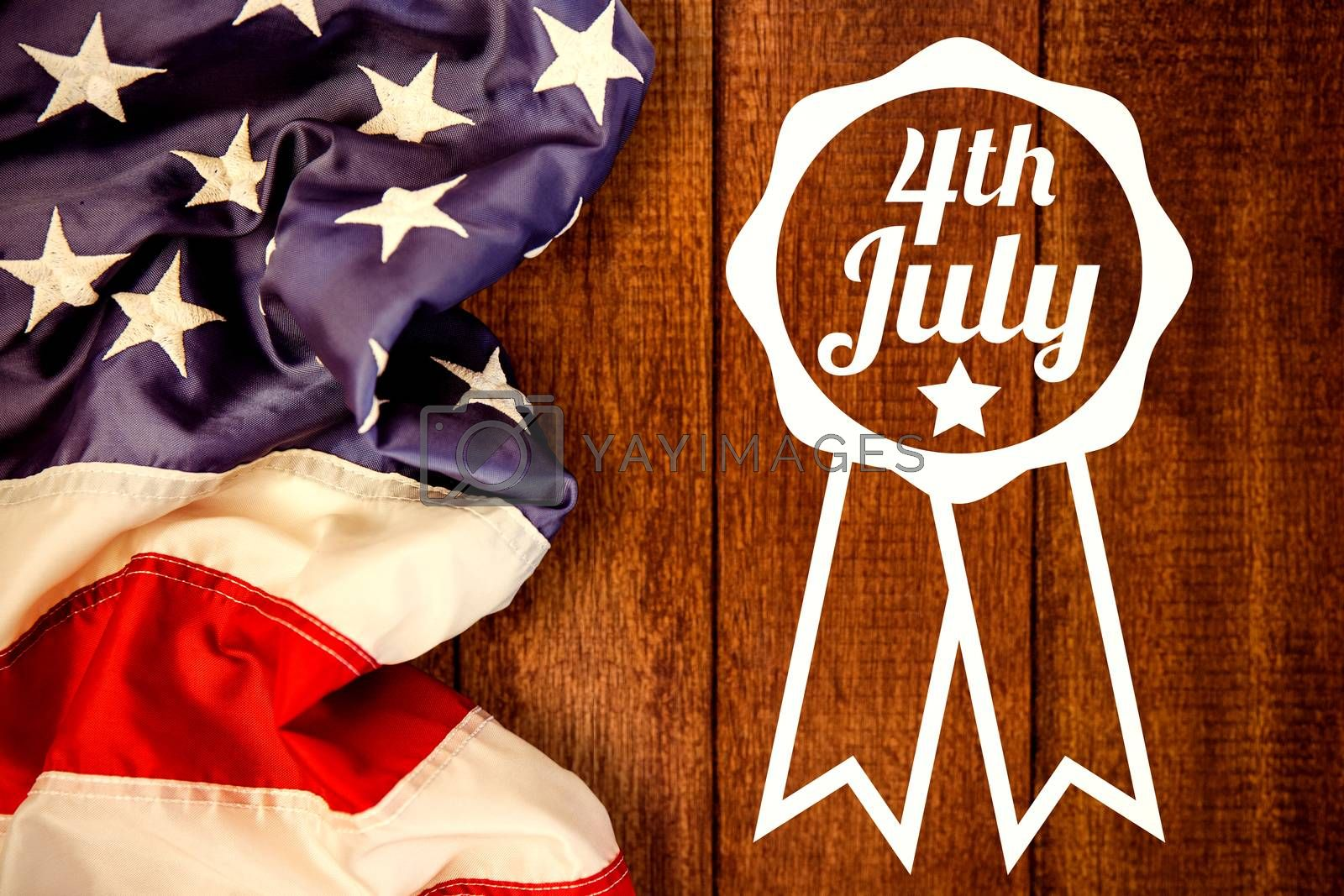 Close up of badge with 4th July text  against wooden background