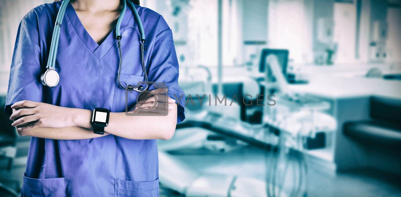 Asian nurse with stethoscope crossing arms against dental clinic