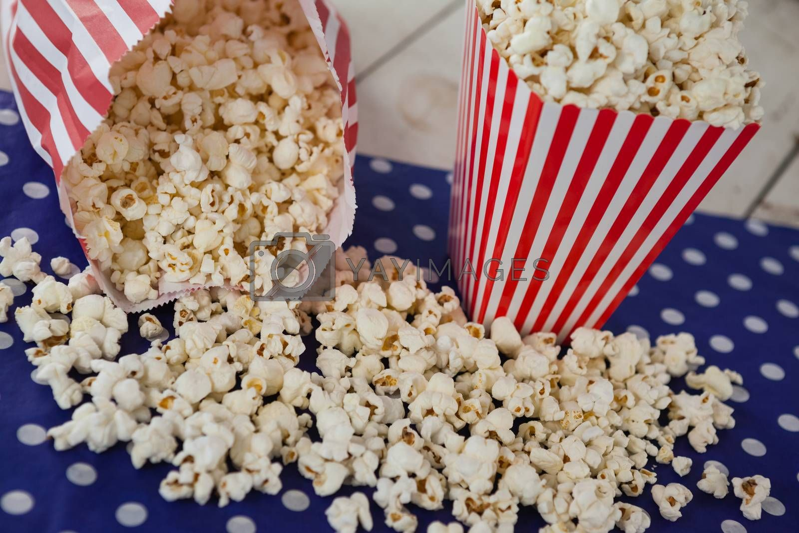 Scattered popcorn on wooden table with 4th july theme