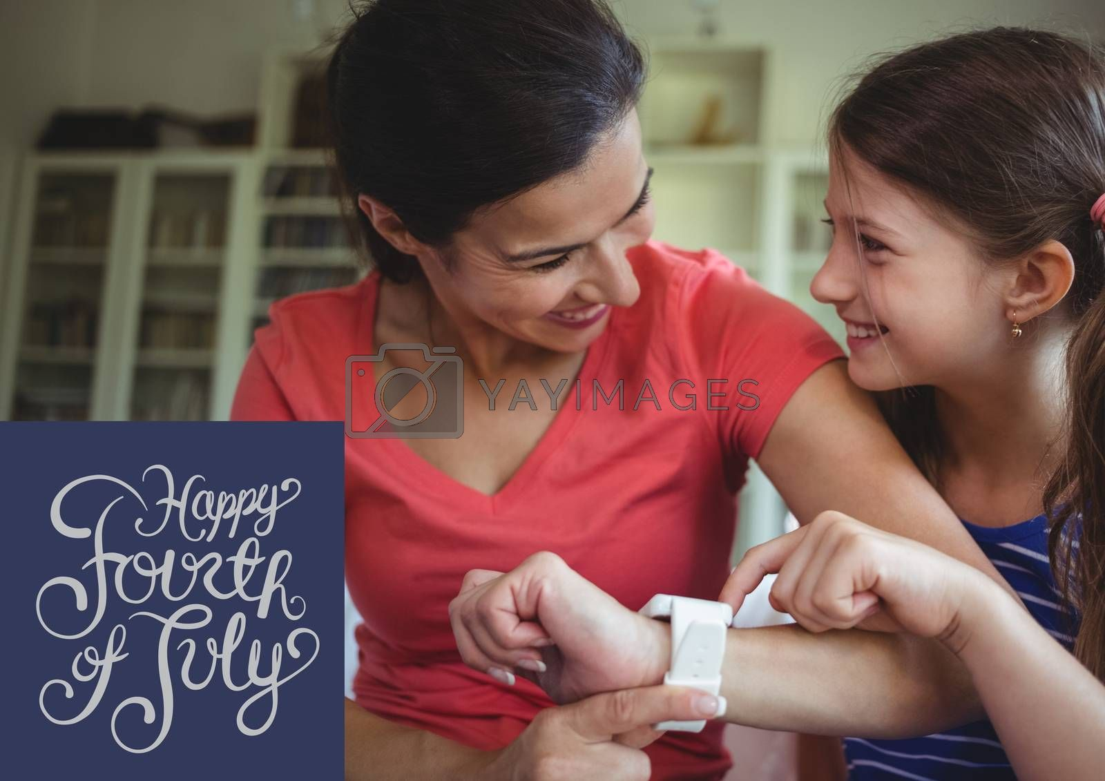 Royalty free image of Smiling girl and her mum celebrating 4th of July by Wavebreakmedia