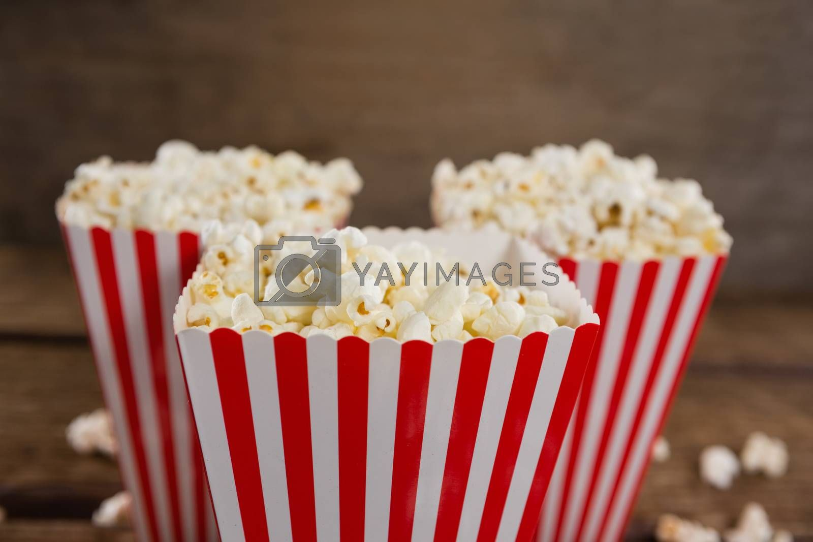 Close-up of popcorn arranged with 4th july theme on wooden table