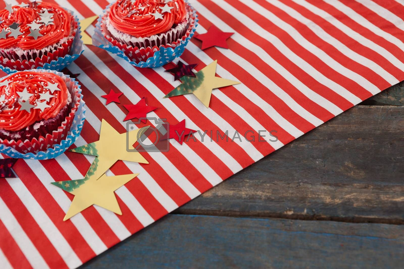 Decorated cupcakes with 4th july theme on wooden table