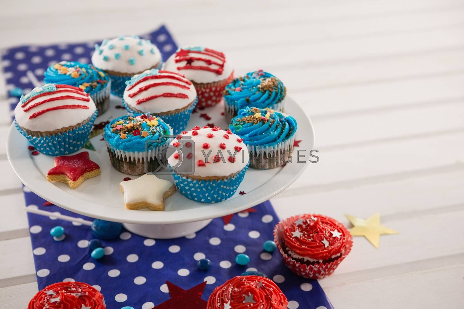 Decorated cupcakes with 4th july theme arranged on plate