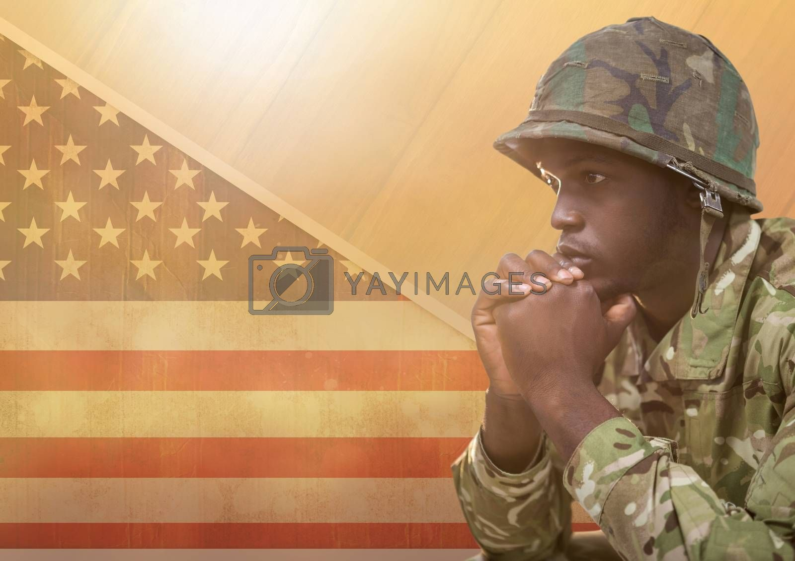 Digital composite of American Soldier thinking  against american flag