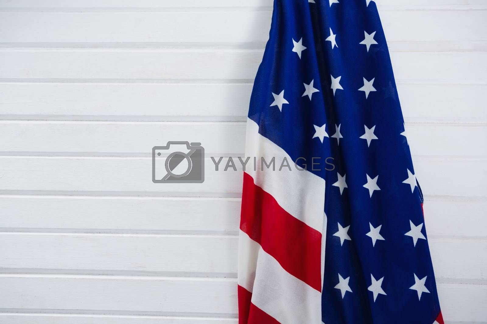 Close-up of an American flag on wooden background