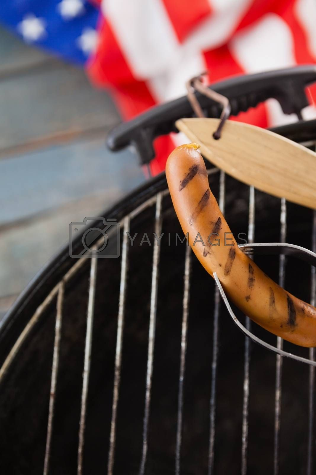 Close-up of sausage on barbeque with 4th July theme