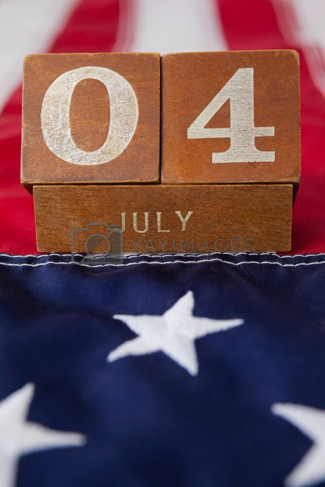 Dates blocks on American flag with 4th july theme by Wavebreakmedia