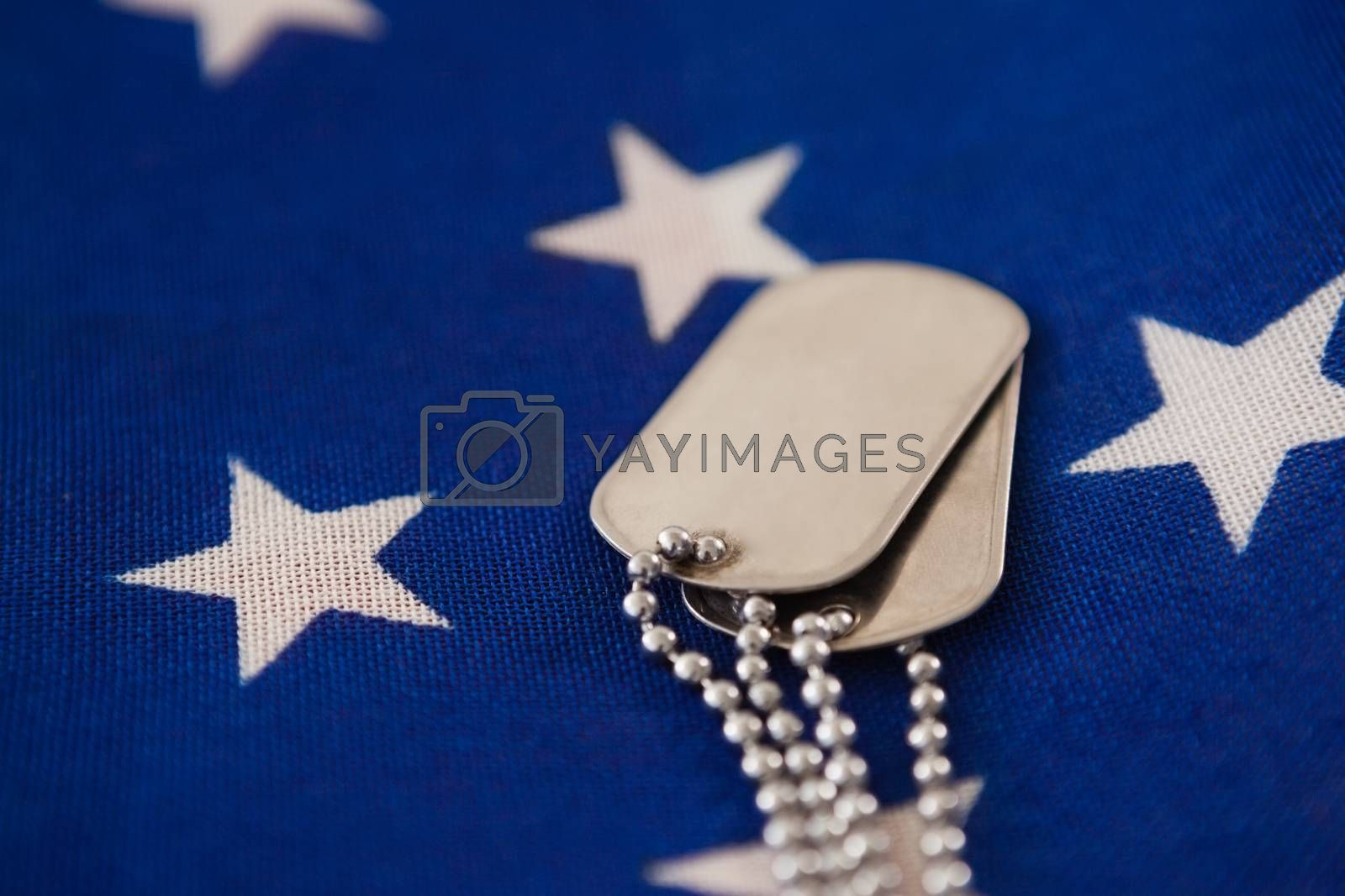 Full frame of dog tag on an American flag