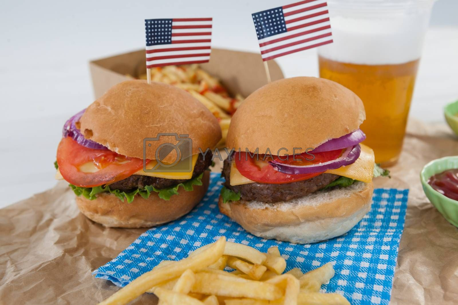 Hamburgers decorated with 4th july theme on brown paper