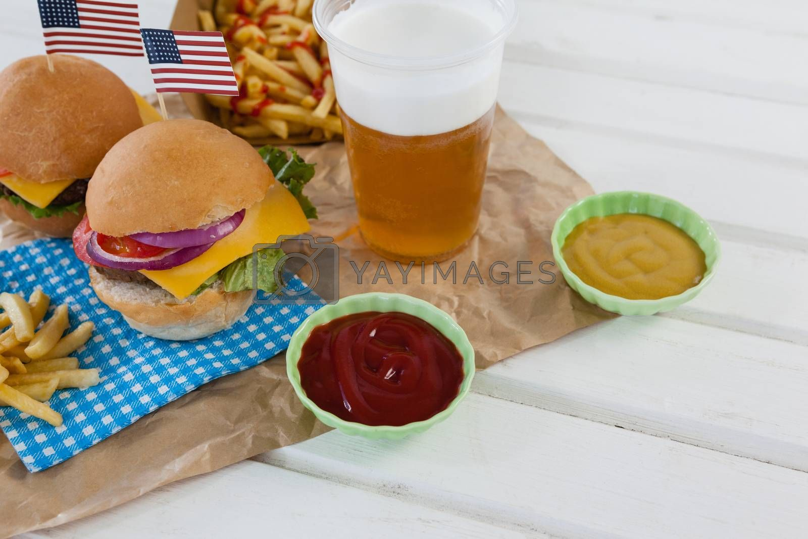 Drink and snacks decorated with 4th july theme on wooden table