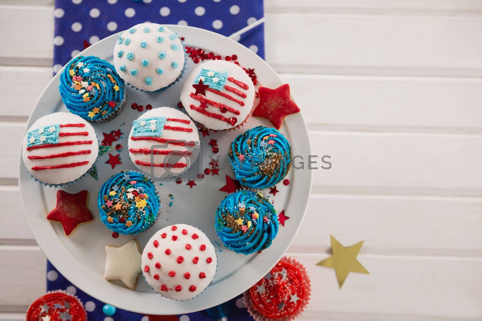 Decorated cupcakes with 4th july theme arranged on cakestand
