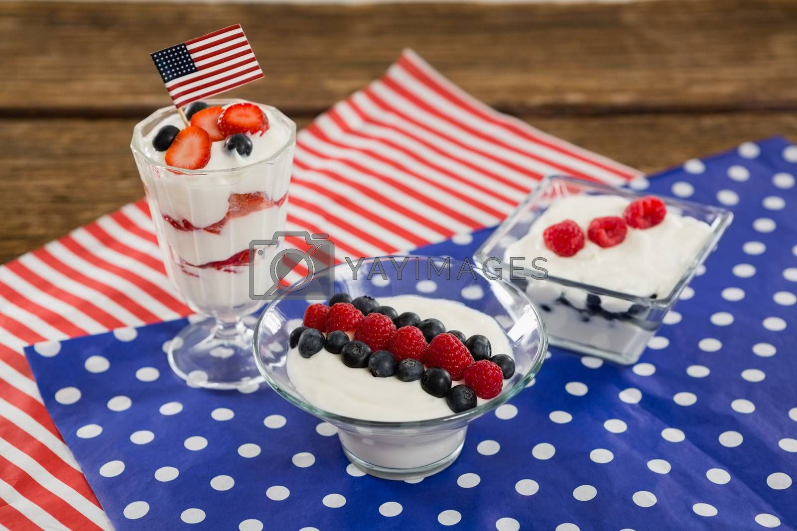 Fruit ice cream with 4th july theme on wooden table