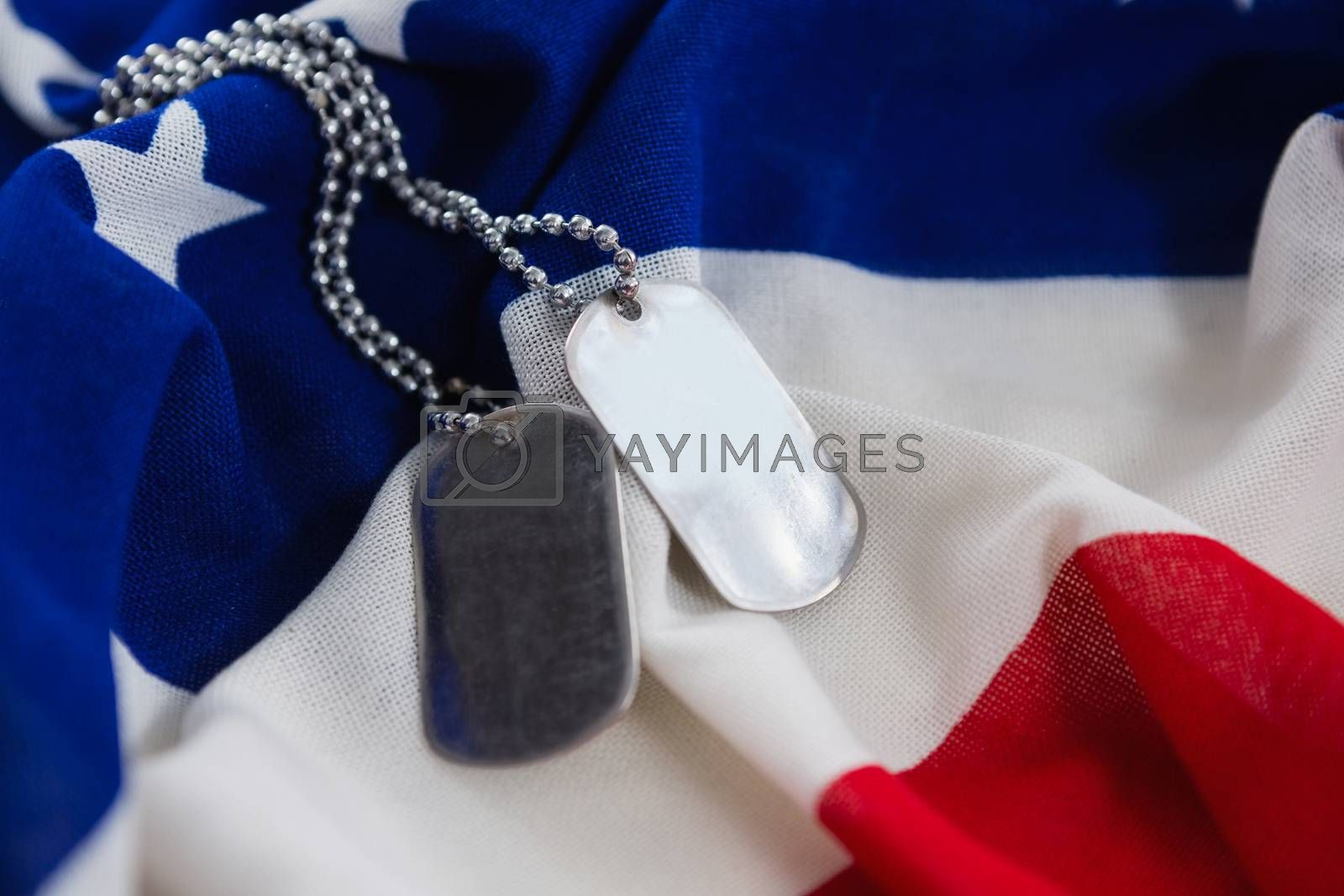 Close-up of dog tags chain on an American flag